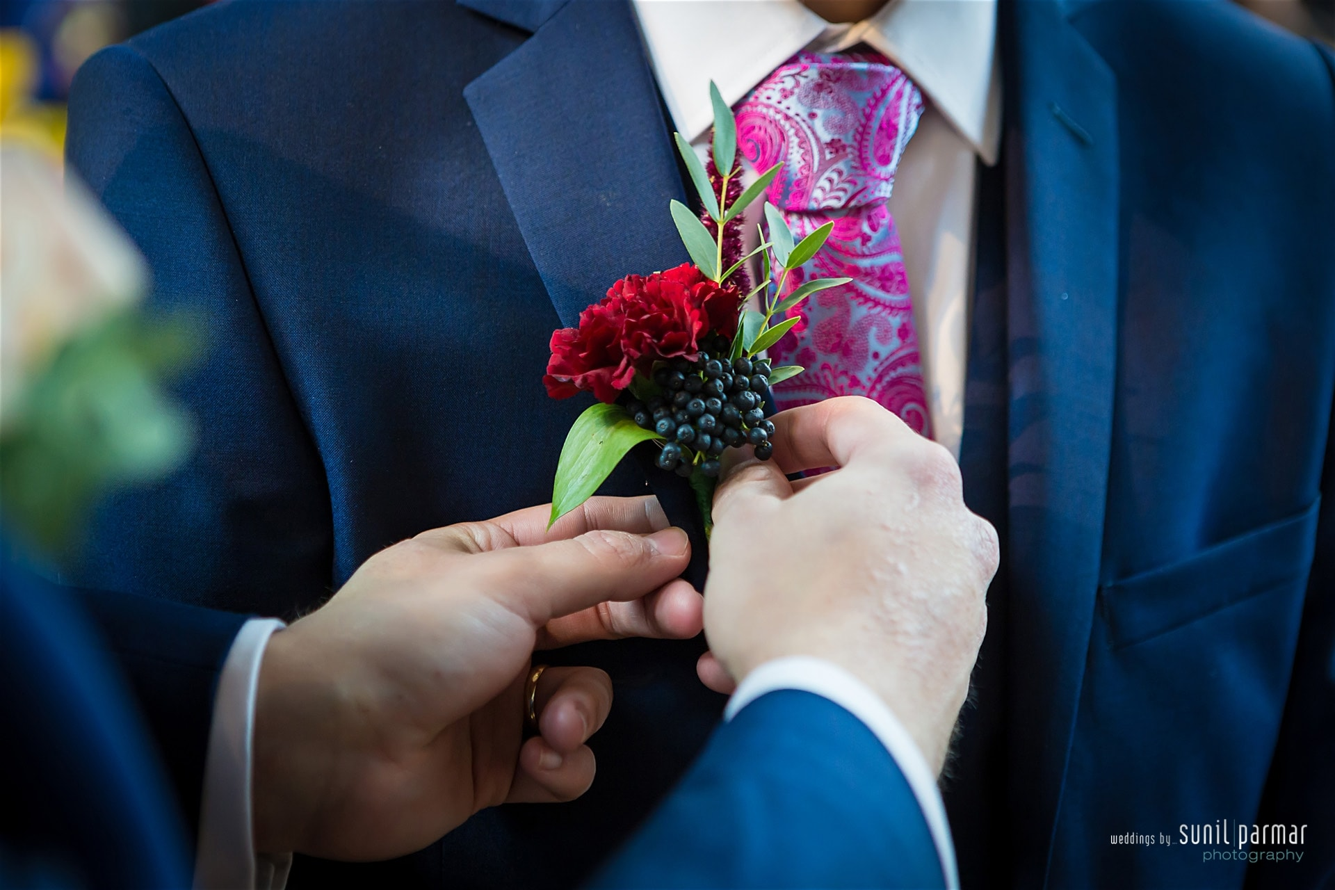Grooms buttonhole with rose and viburnum berry