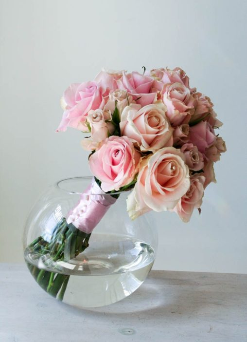 A brides bouquet of antique pink roses, arranged in a timeless dome, created by London florist Garland