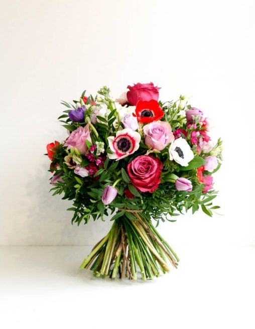 Birthday bouquet with a mixture of red, pink and purple anemone and roses