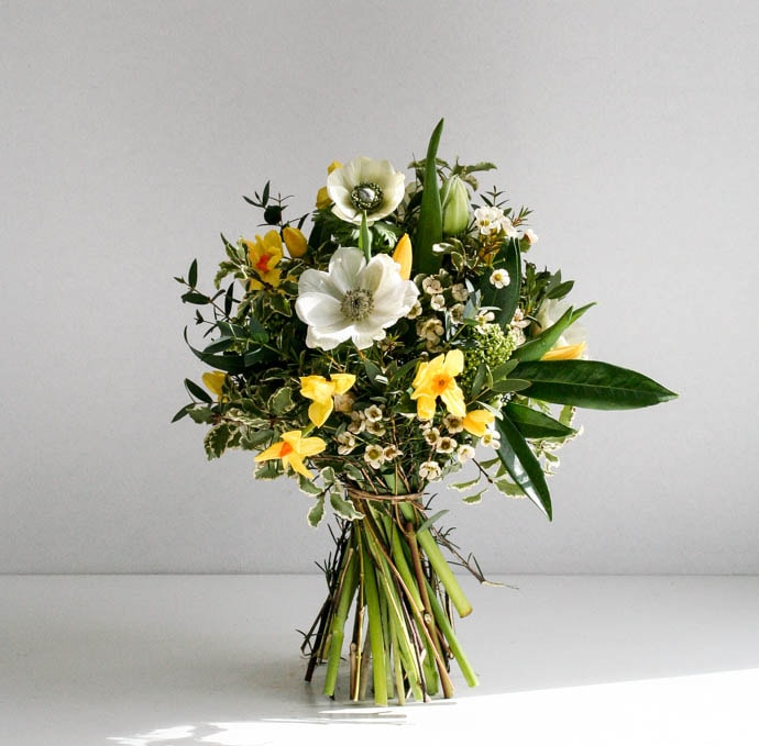 Spring bouquet of daffodils and anemone, created by London florist Garland