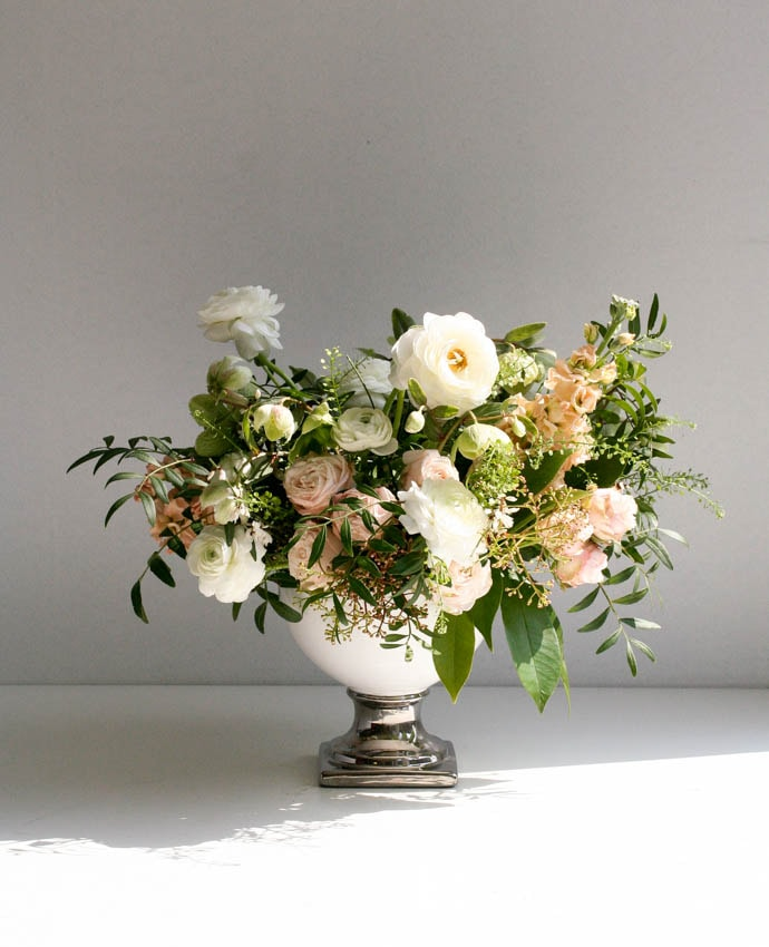 Peach and white elegant wedding centrepiece, created by London florist Garland