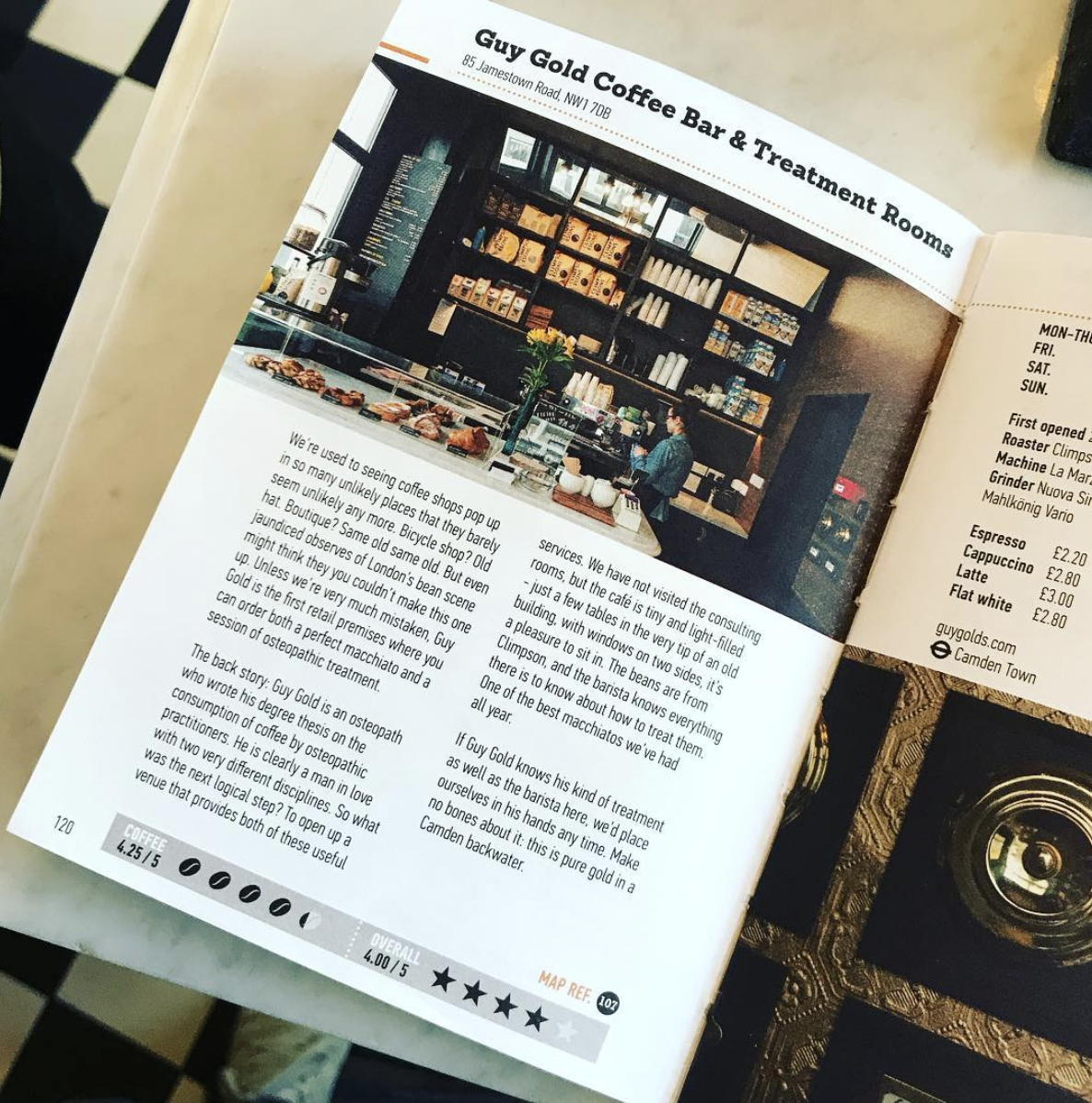 An image of the London Coffee Guide, open to a page showing Guy Gold's Osteopathy Practice and Coffee Bar in Camden, London