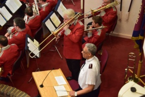 Commissioner Adams waits to lead a song while Andrew Justice finishes his solo in Just a closer walk. The Trombone part for Croydon Citadel is also close at hand.