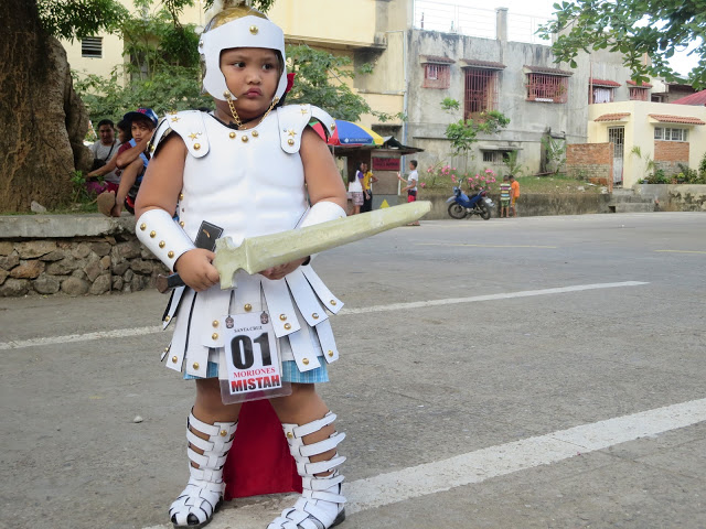 a young child wearing moriones outfit