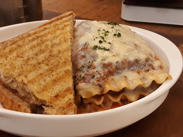 toasted bread with baked lasagna