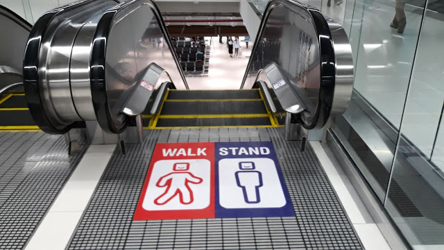 escalator etiquette stand on right walk on left