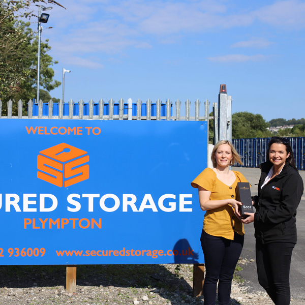 Secured Storage director Natalie Payne receiving an award from Willbox Regional Sales Manager Laura Johns
