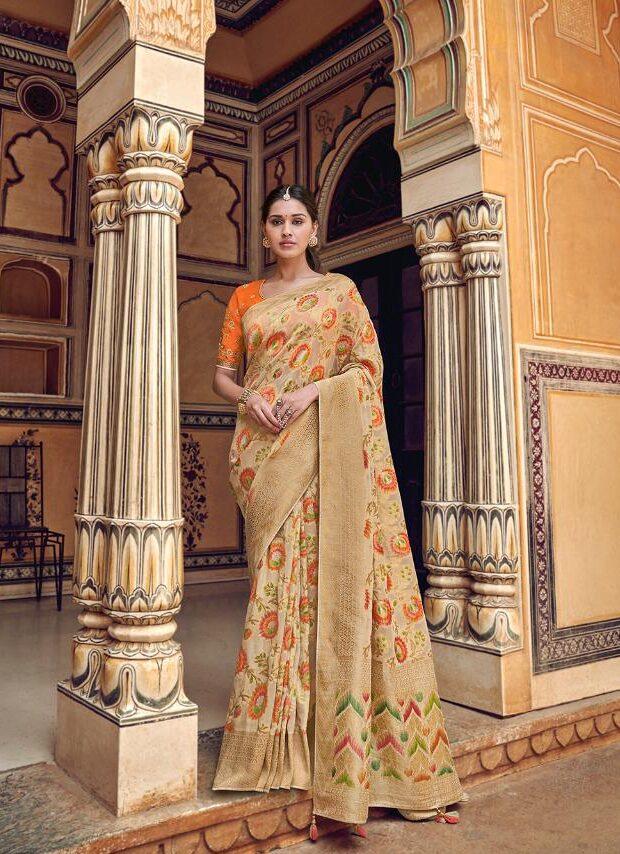 New Designer Best Embroidered Orangei-cream Party-wear saree.