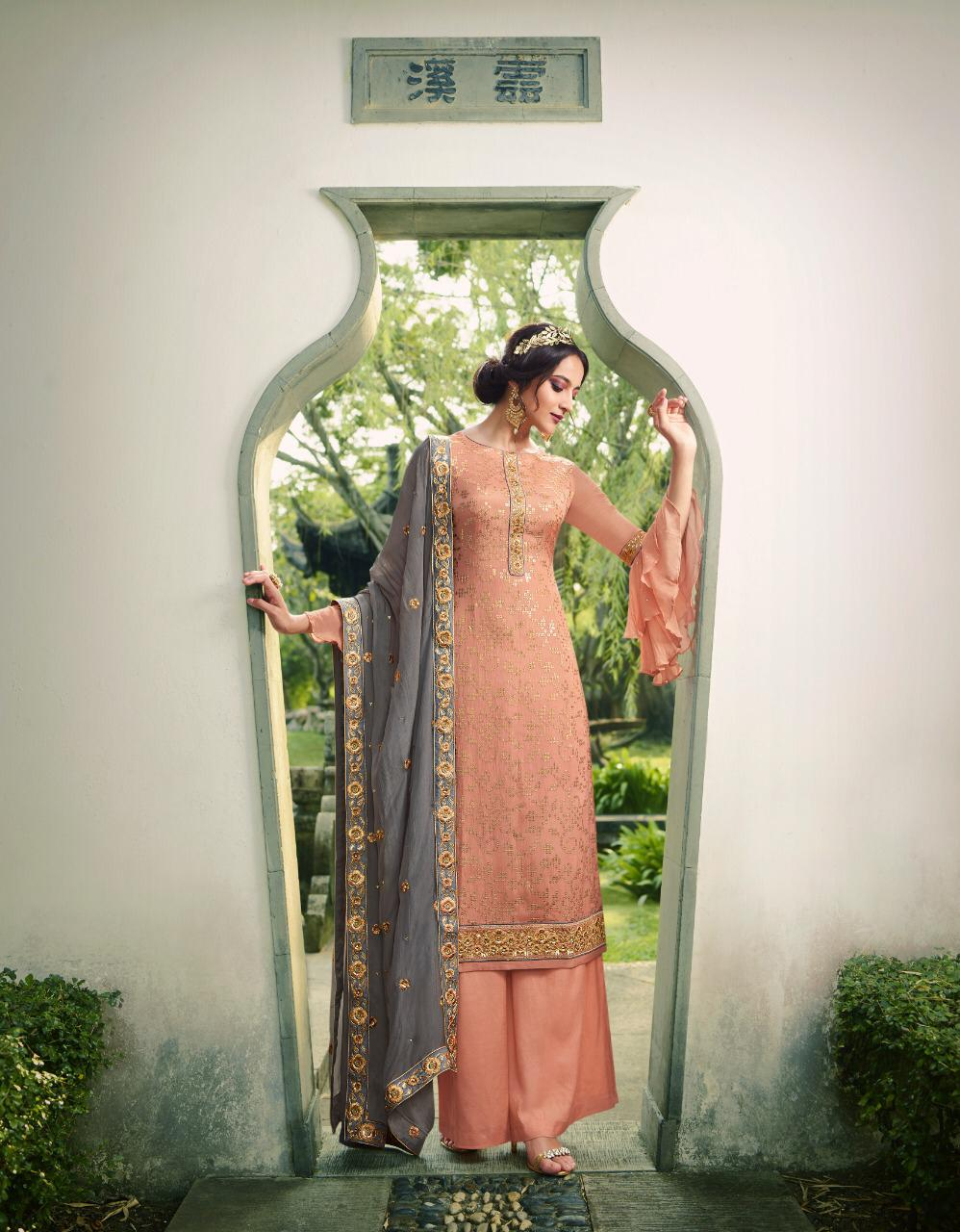 Best embroidery light pink color pure santoon suit with chinnon dupatta.
