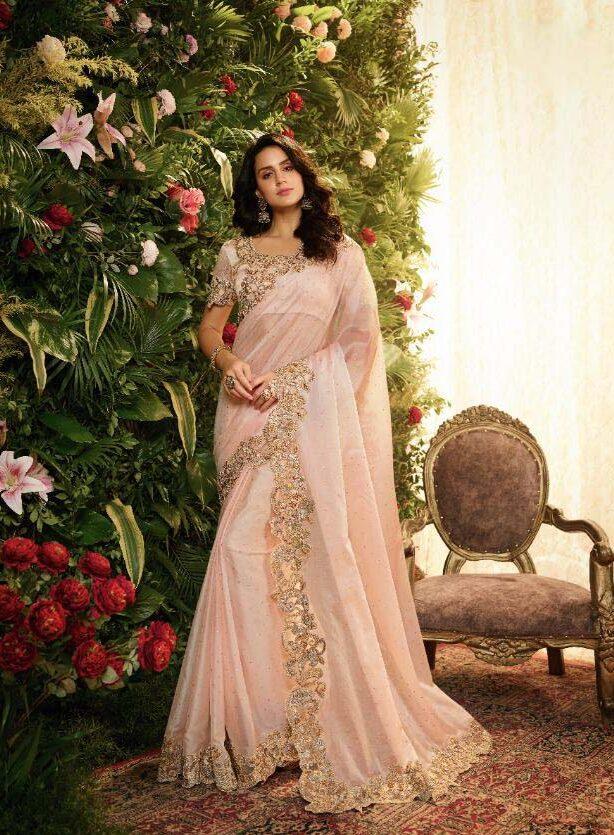 New designer pink color heavy silk saree online.