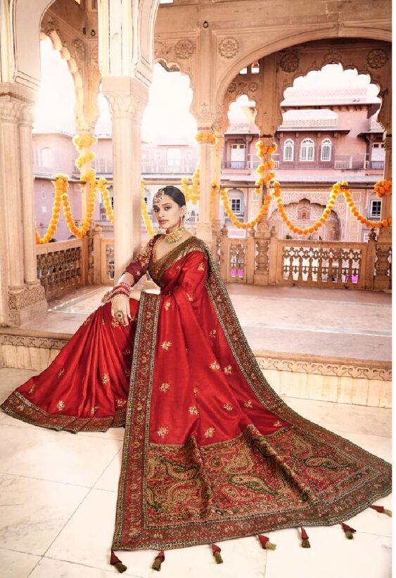 New designer red color dola silk wedding saree.