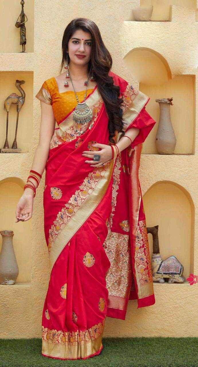New designer red color party wear silk saree with contrast blouse.
