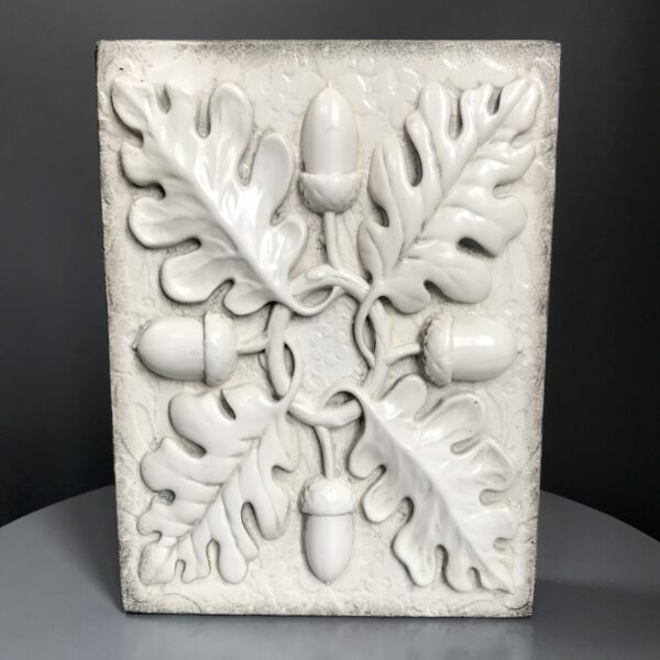Acorn Sid Dickens Memory Block which is Canadian made inscribed with 'Gem of the mighty oak, A symbol of strength and prosperity.'
