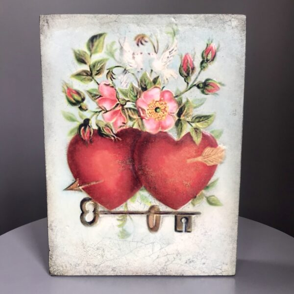 Mi Amore SP01 Sid Dickens Tile shows 2 vibrant red hearts which reads 'Two hearts standing together, partners in life and love.'