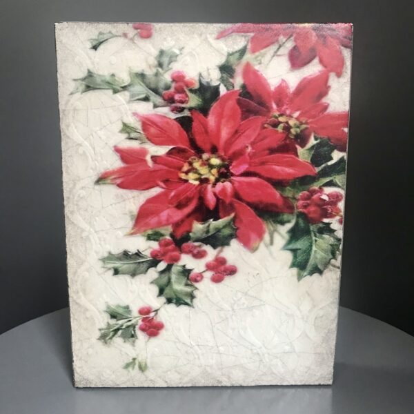 Poinsettia T497 Retired Sid Dickens Tile which is red plant on a white background with green leaves.