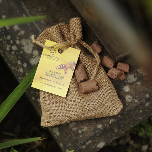 Bee Bomb Wildflower Seeds hessian bag with a yellow tag