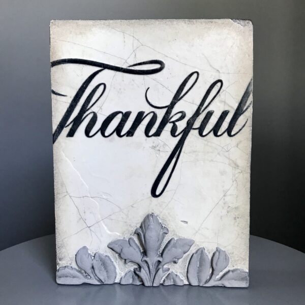 the word thankful in black on w white background