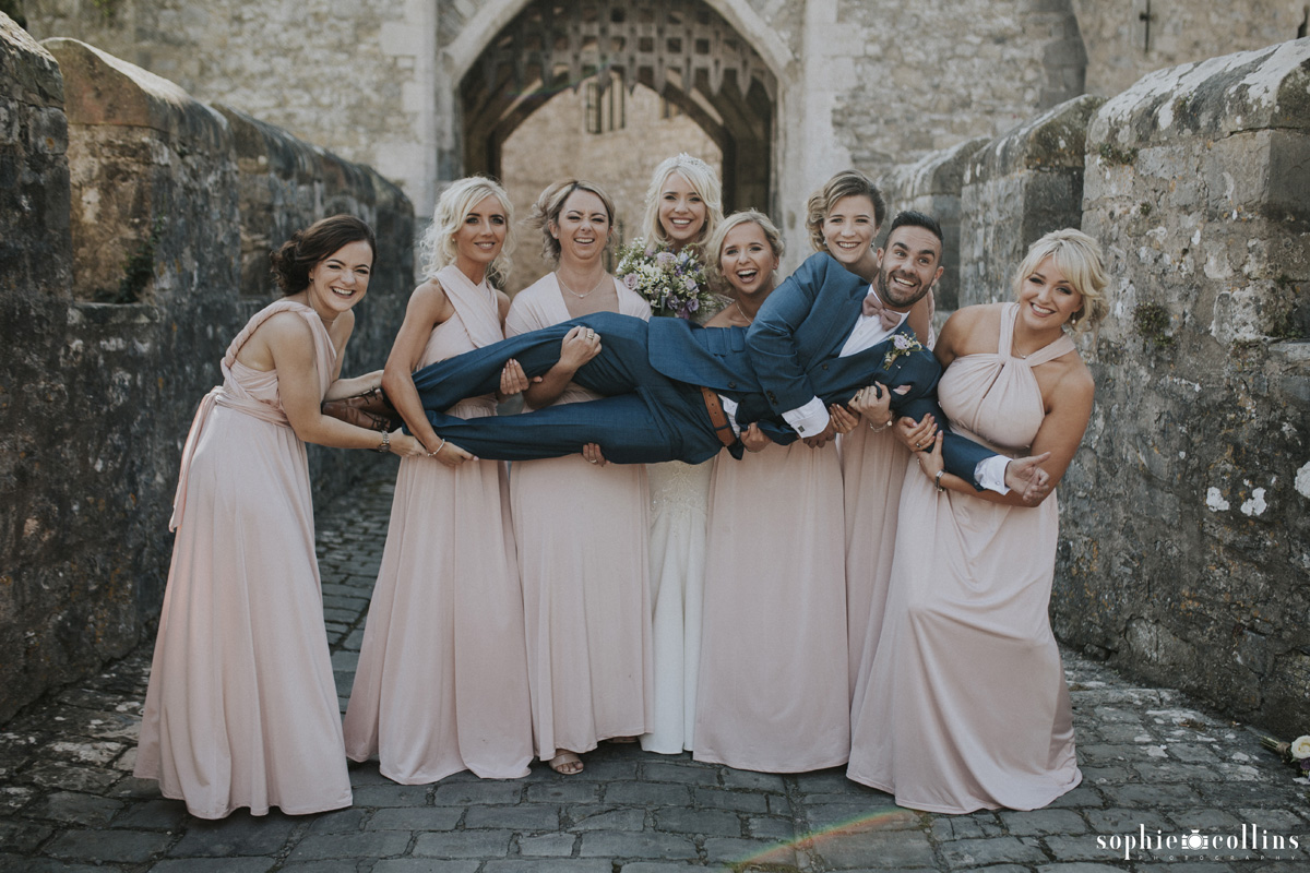 bridesmaids lifting groom