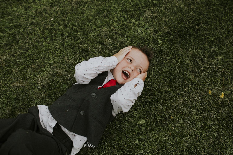 little boy playing at wedding