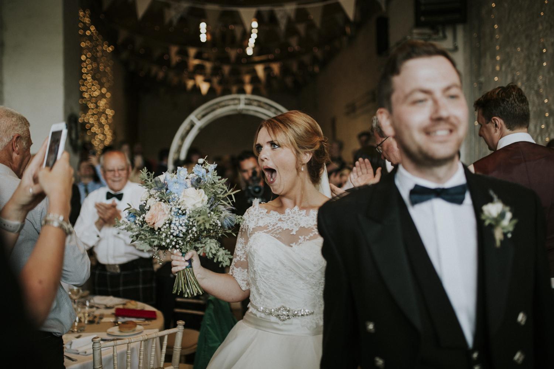 bride and groom walk in reception