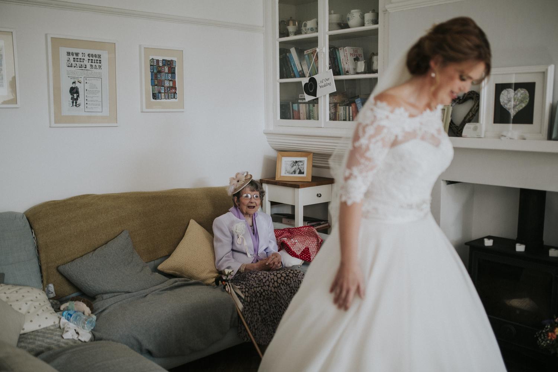 nan smiling at granddaughter in dress