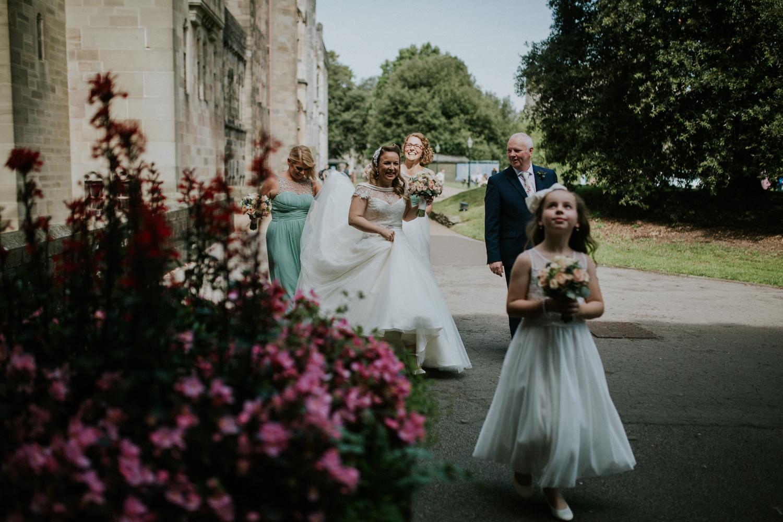 bride and bridesmaids walking towards ceremony