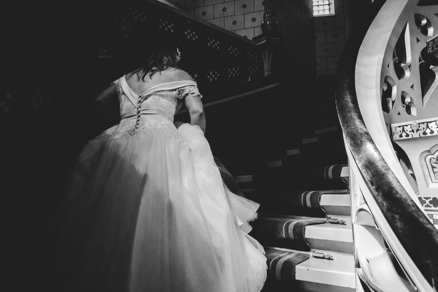 bride walking up cardiff castle staircase