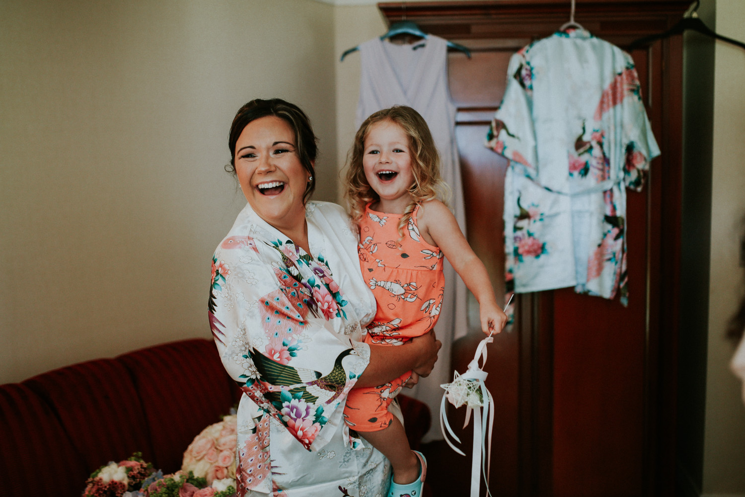 bride and daughter laughing