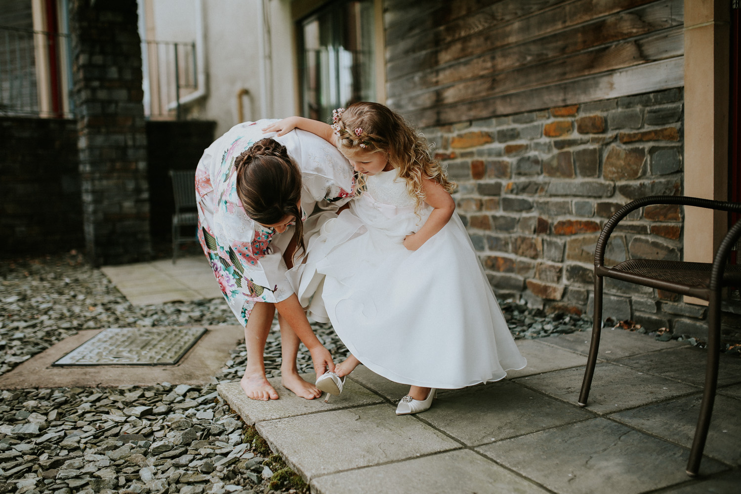 little girl trying on brides shoes