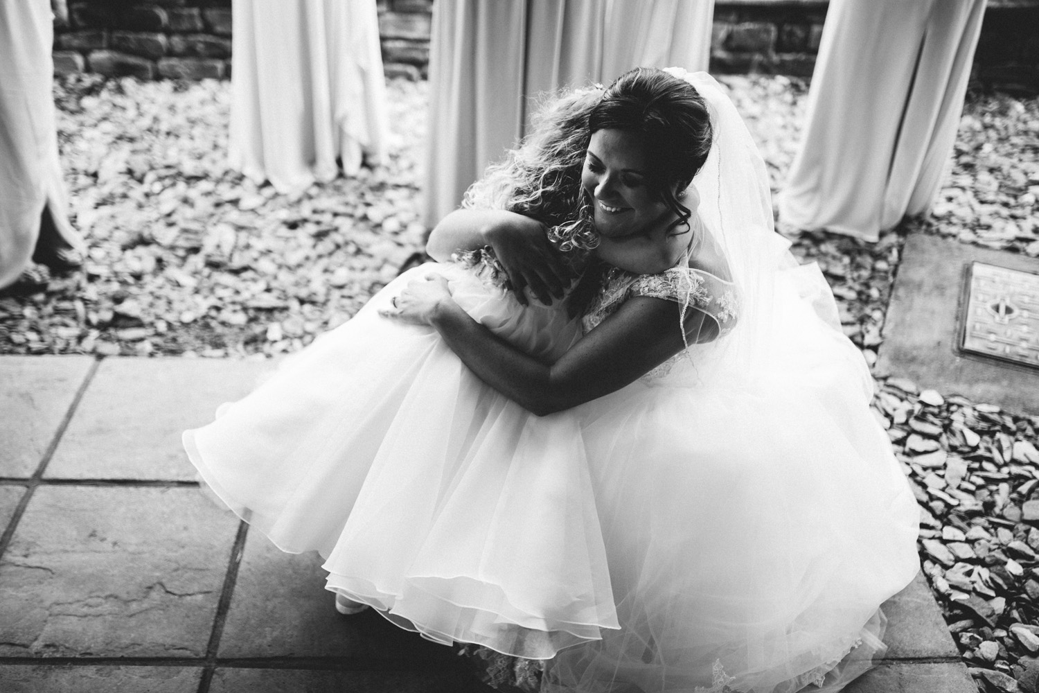 bride and daughter hugging