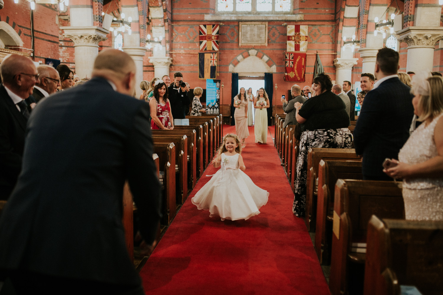 daughter running to dad down the isle