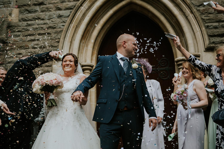 confetti in grooms face