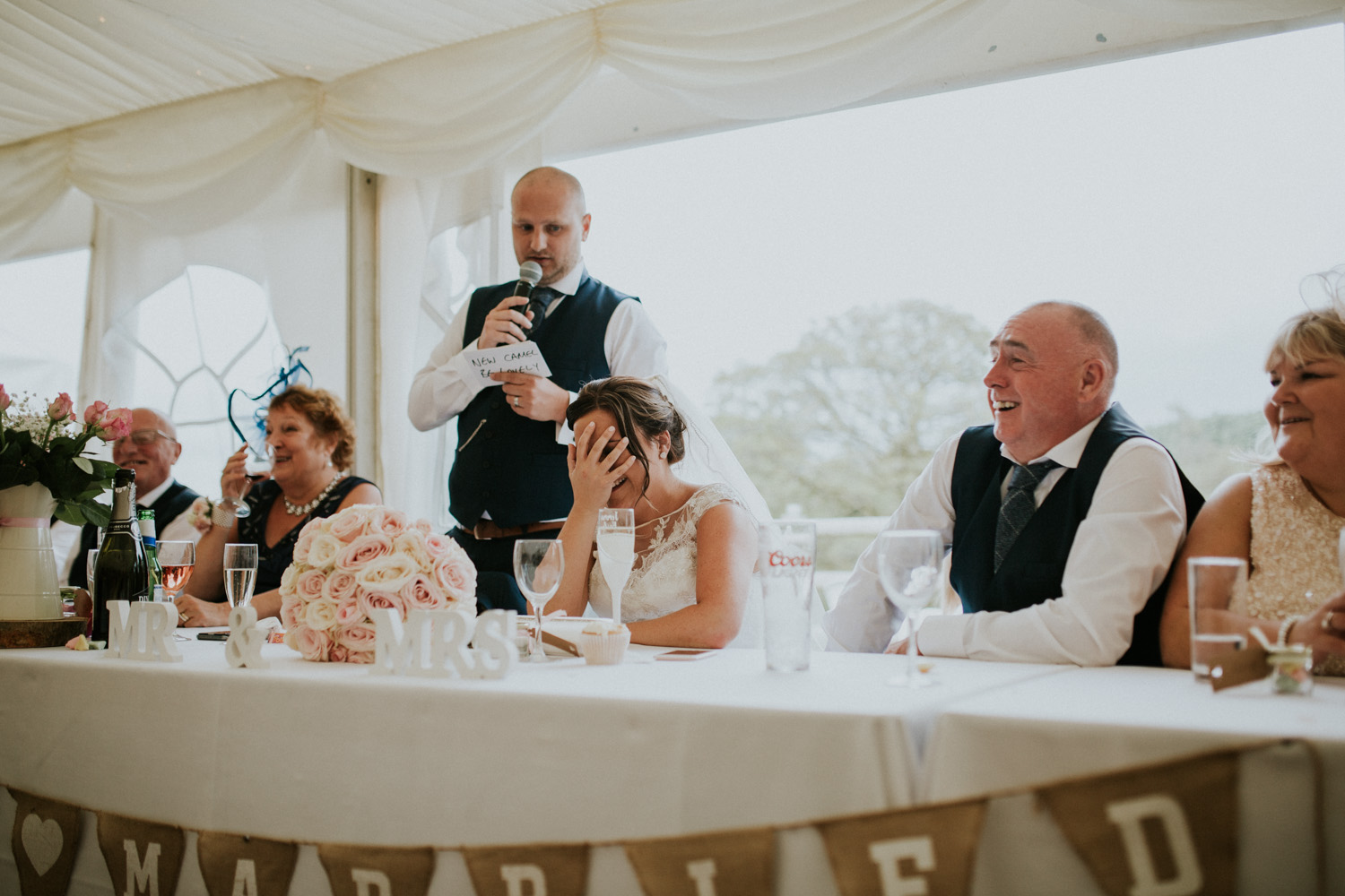 bride laughing and grooms speech