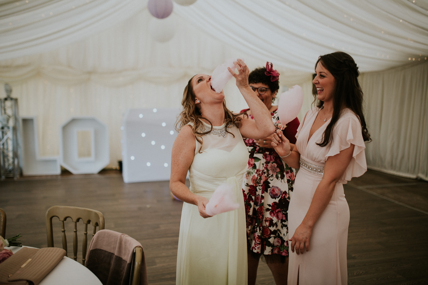 bridesmaids eating candy floss