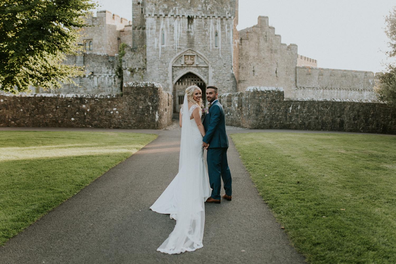 bride and groom portrait outside st donats castle