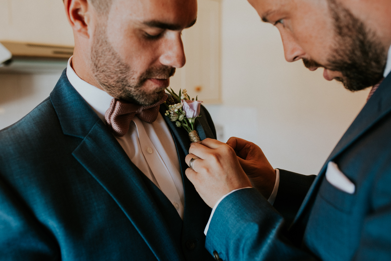 groom putting on his flower
