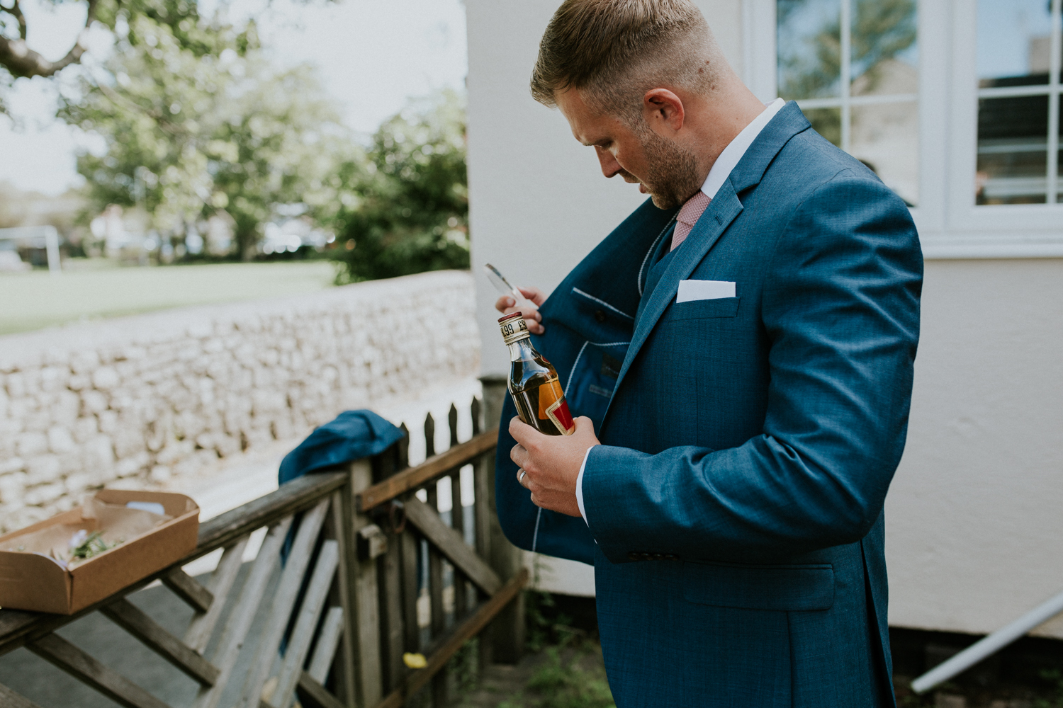 groom with hip flask