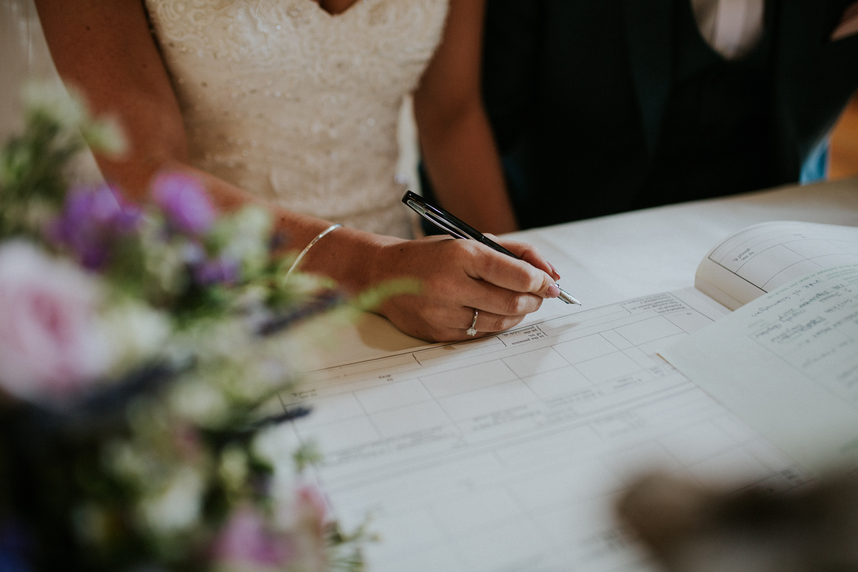 bride singing the registrar