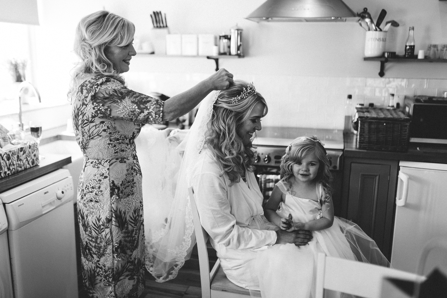 mother of the bride putting the brides vail in