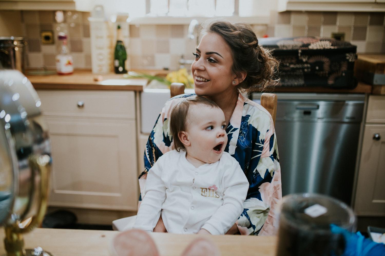 baby and bridesmaid