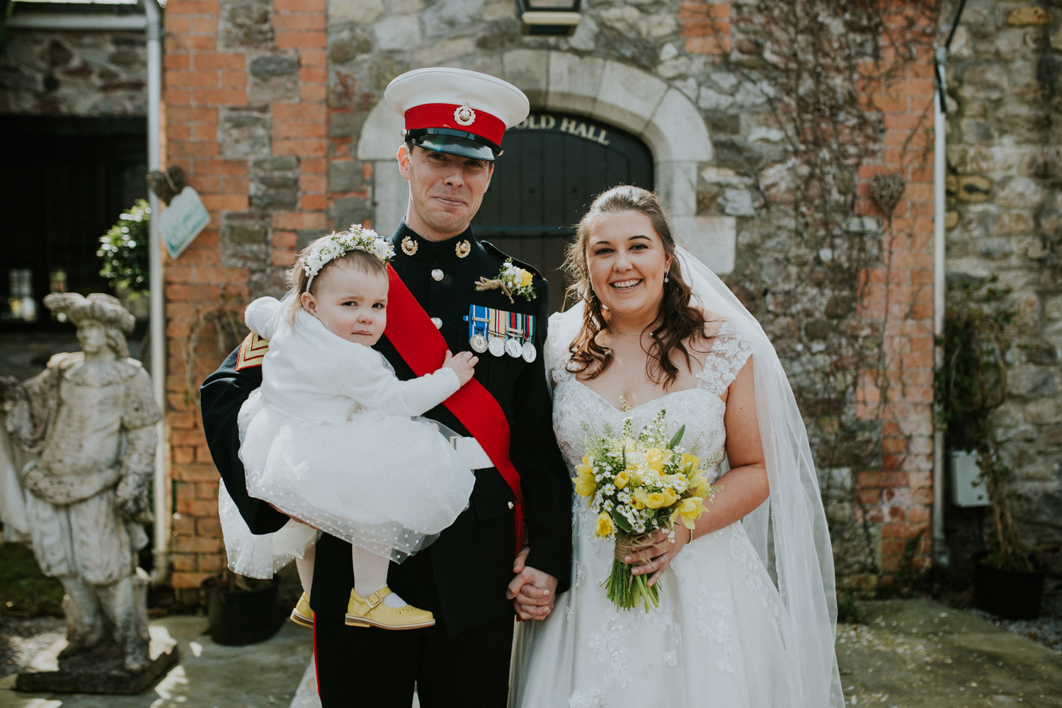 bride, groom and daughter