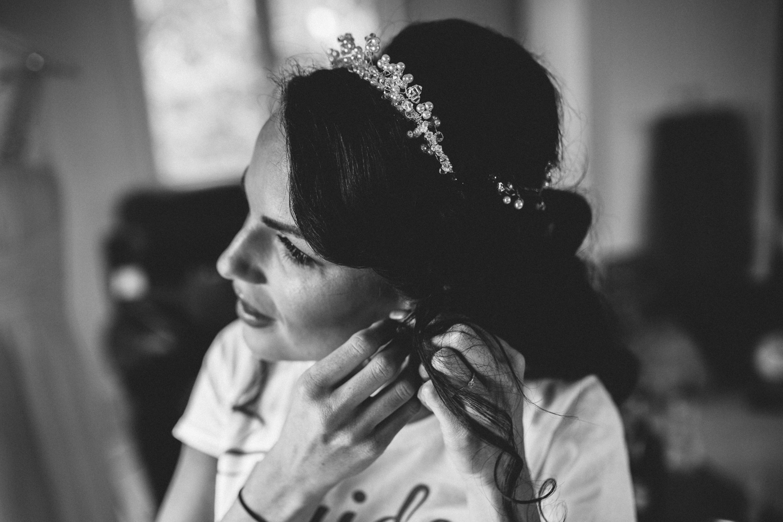 bride putting earring in