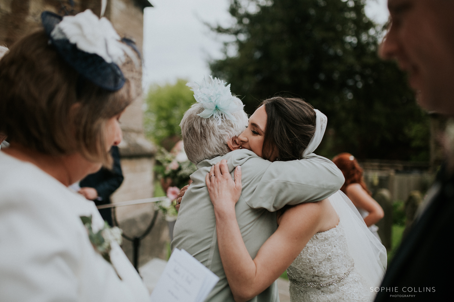 guest hugging bride
