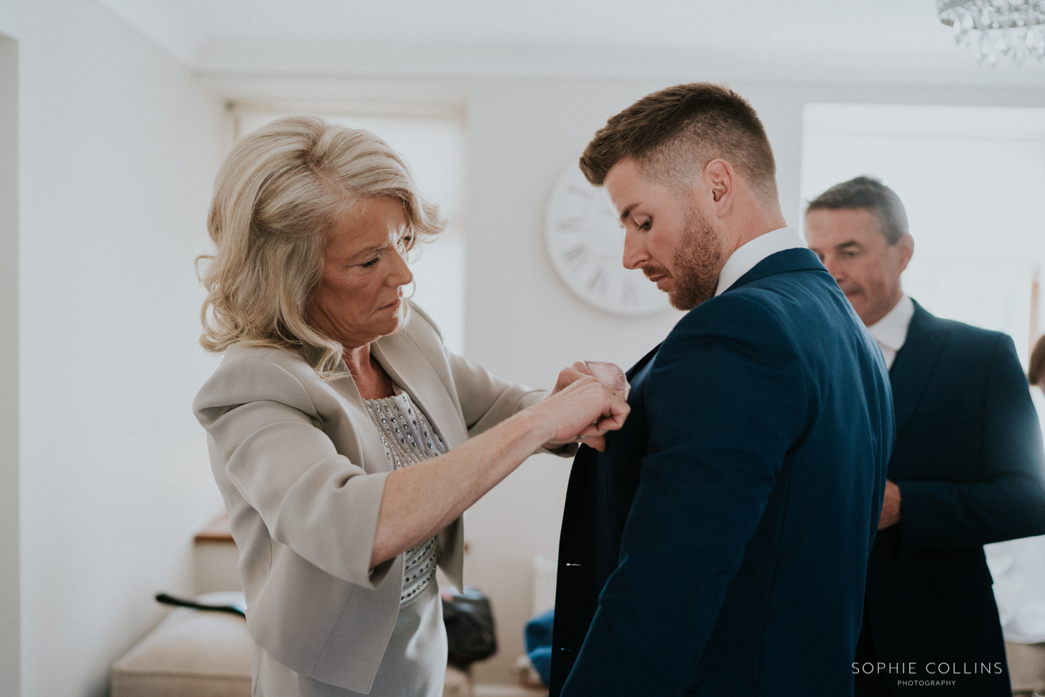 mother of the groom doing grooms flower