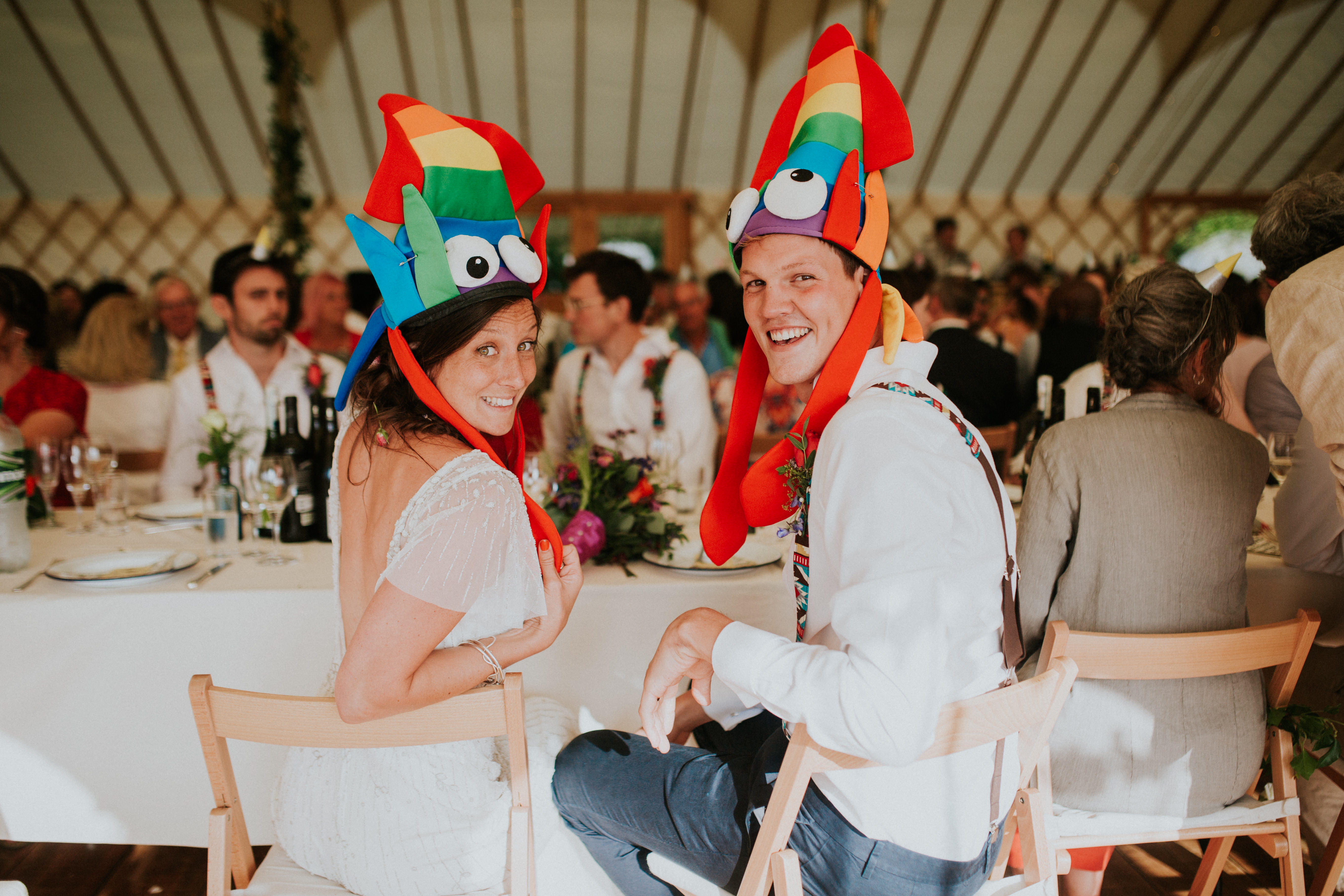 bride and groom wearing funny hats