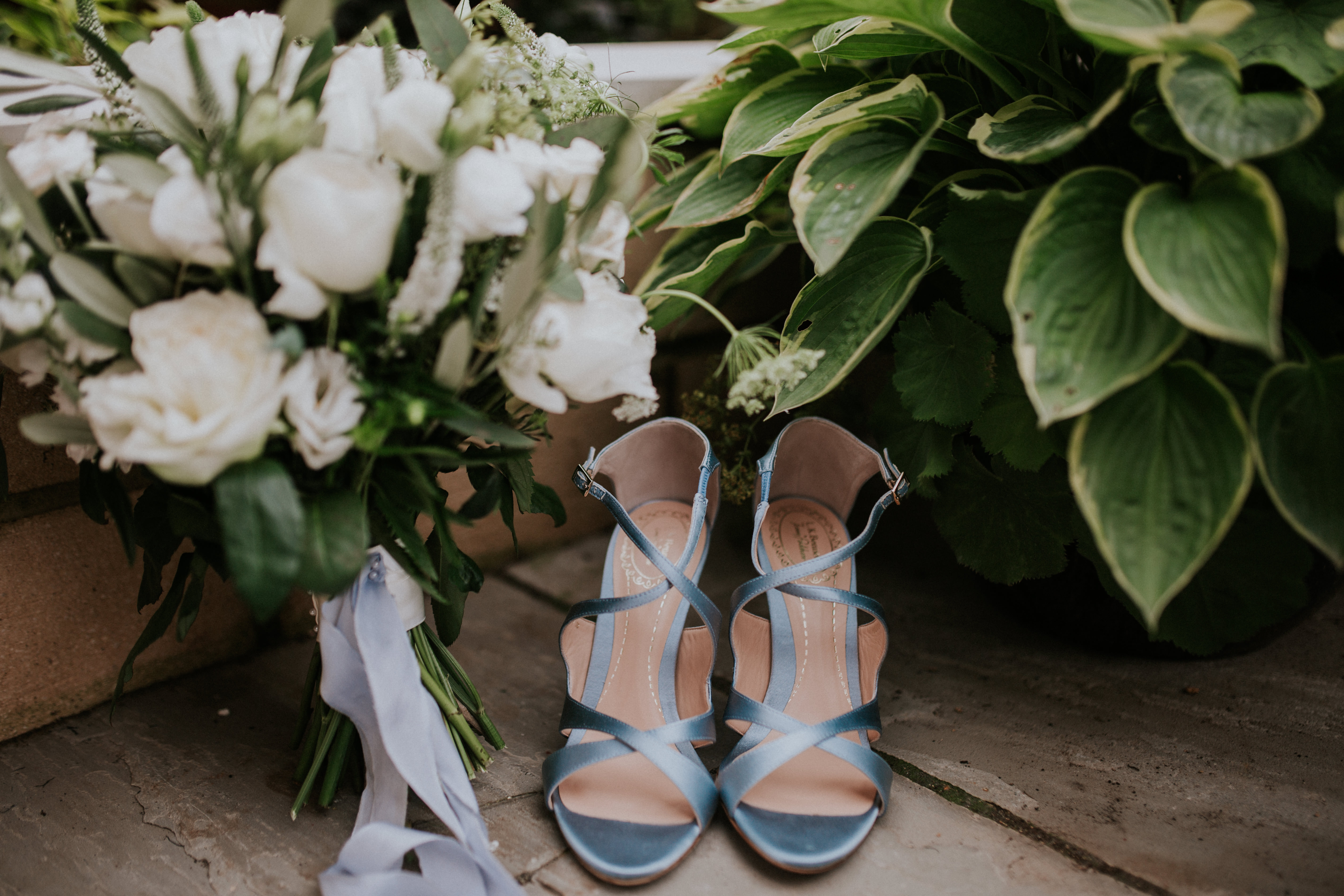 bride shoes and flowers