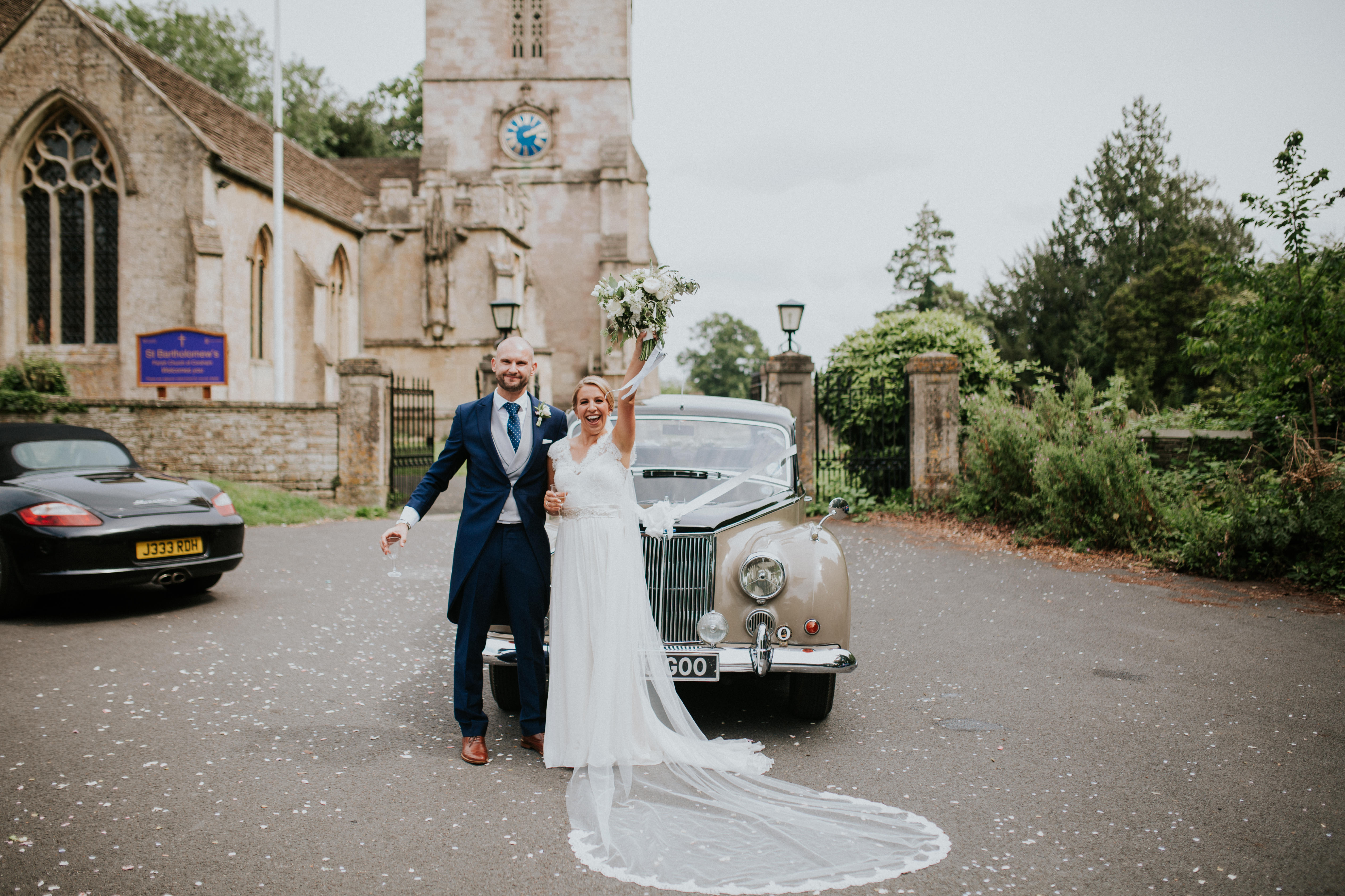 bride and groom portrait with the car