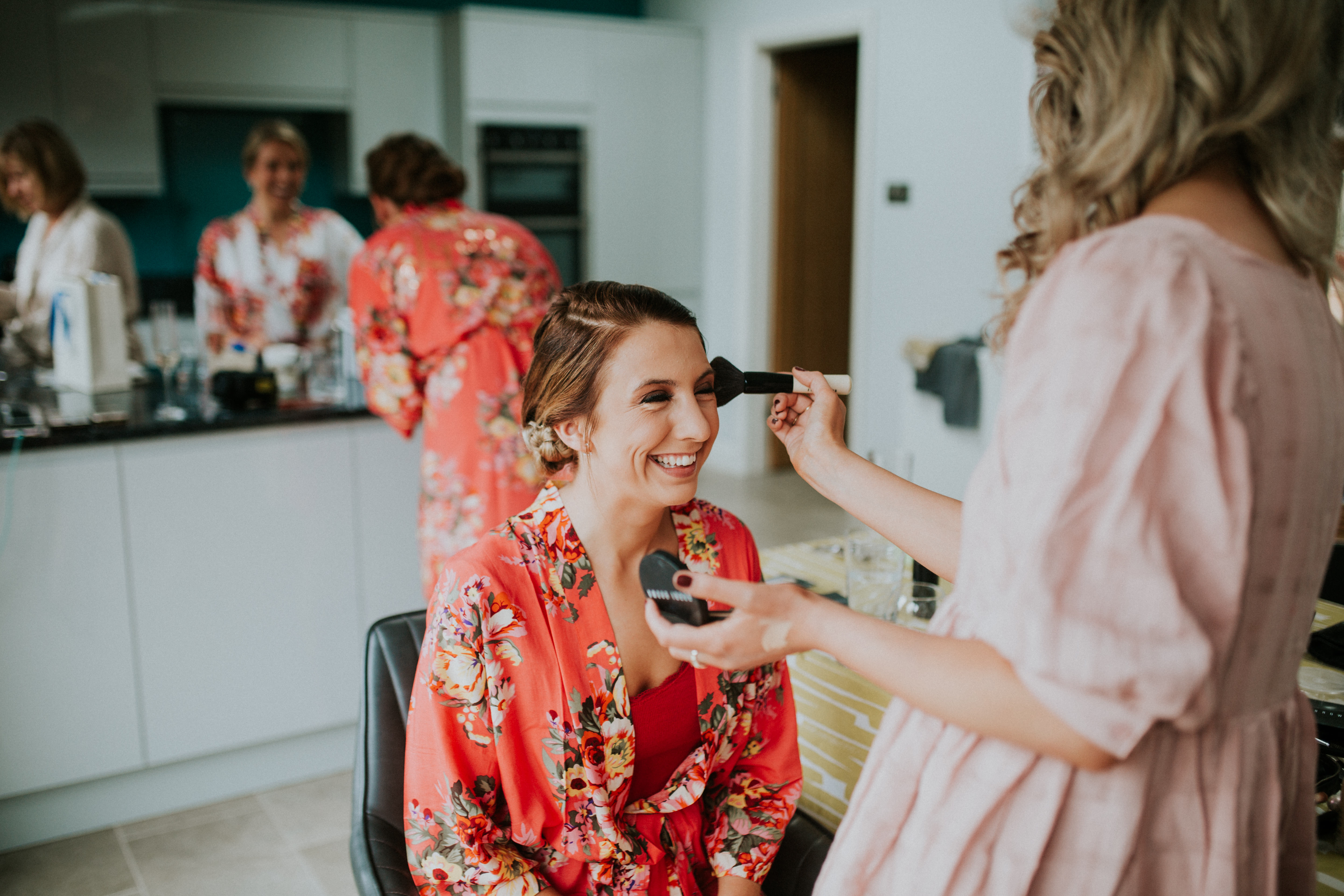 bridesmaid having make-up done