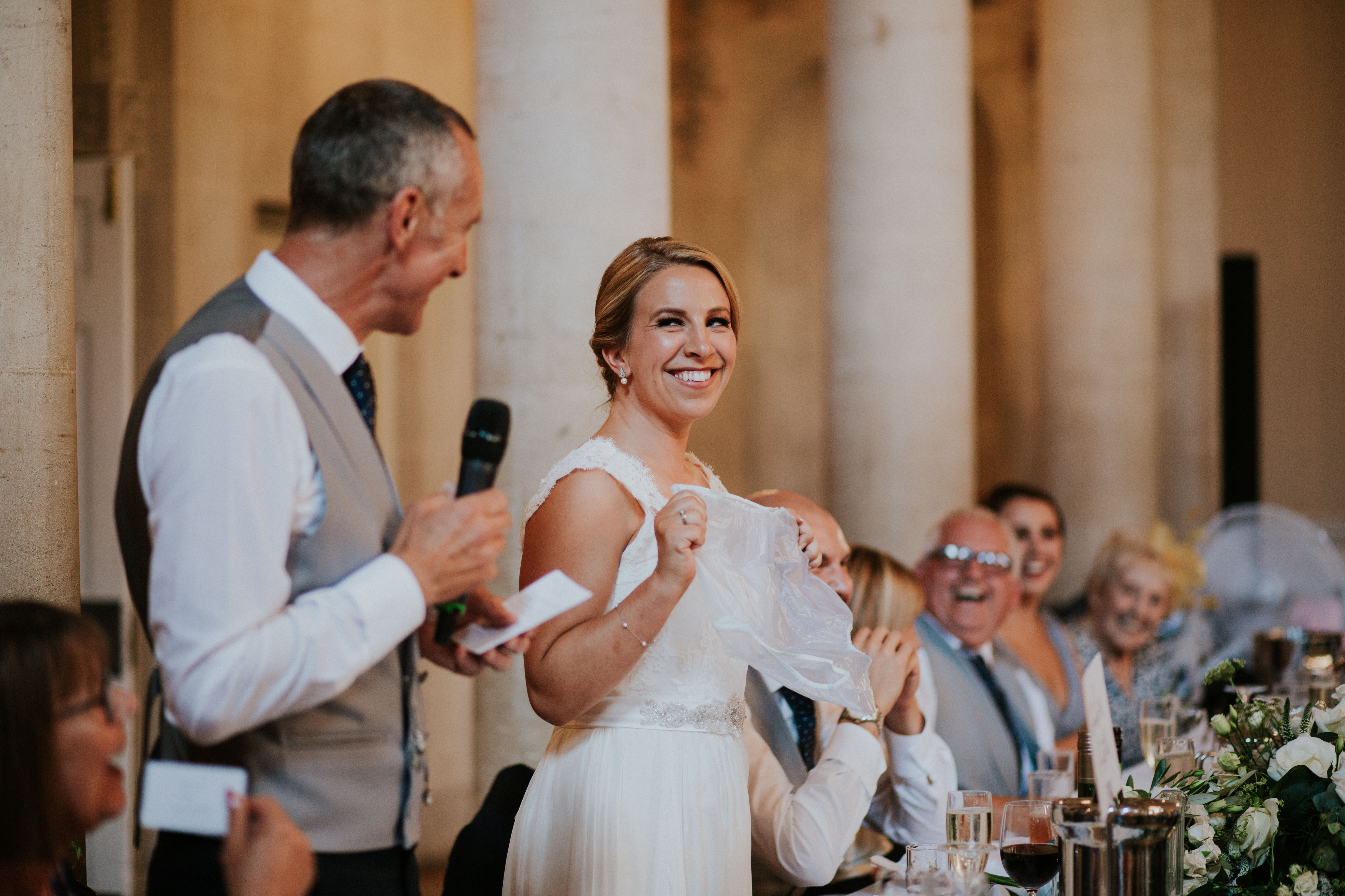 bride laughing at dad