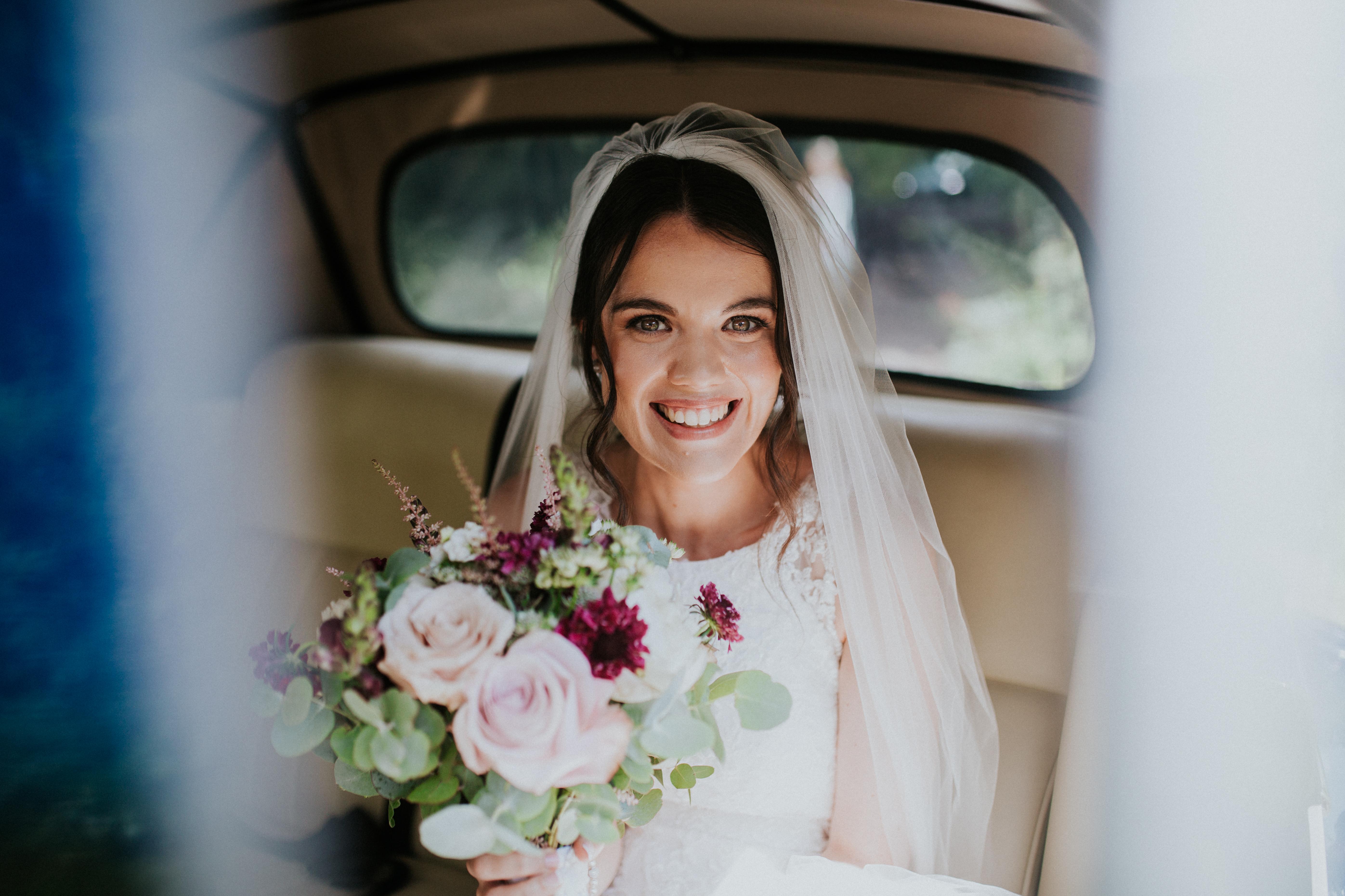 bride in the wedding car